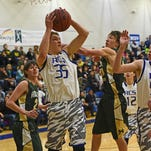 Luke Fick, shown in a game earlier this season, hauls in a rebound for the undefeated Resurrection Christian basketball team. The Cougars are the No. 1 seed in this week's regional tournament.