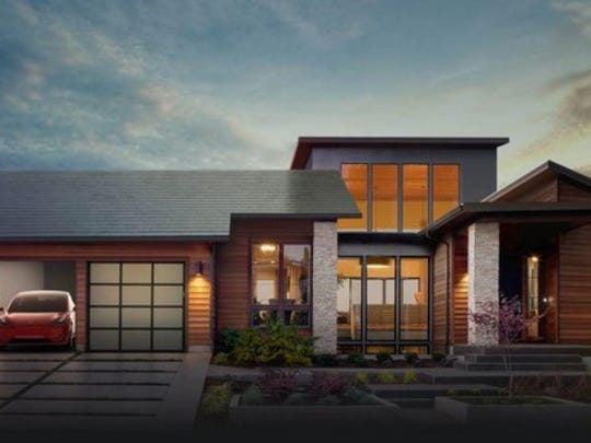 Tesla and SolarCity's planned solar roof, along with a Tesla Powerwall and a Model 3 car.