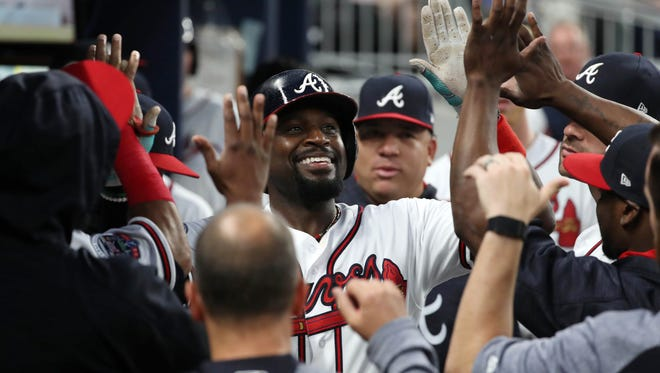 Atlanta Braves second baseman Brandon Phillips (4) celebrates his solo home run in the third inning against the Pittsburgh Pirates at SunTrust Park on May 22.