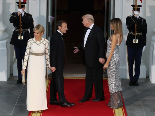 President Trump and first lady Melania  greet French