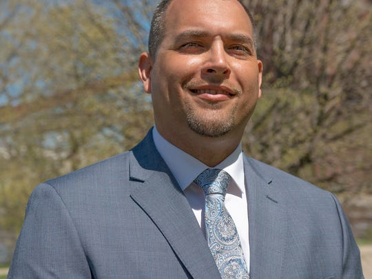 Jeremy Garza, a licensed plumber, has been elected as Lansing's 2nd ward councilmember. His term begins Jan. 1.