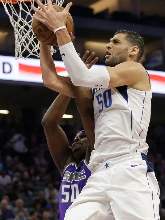 Dallas Mavericks center Salah Mejri, right, grabs a rebound over Sacramento Kings forward Zach Randolph during the first half of an NBA basketball game Saturday, Feb. 3, 2018, in Sacramento, Calif. (AP Photo/Rich Pedroncelli)