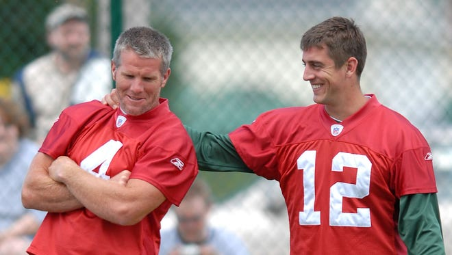 Green Bay Packers quarterbacks Brett Favre and Aaron Rodgers kid around during 2006 organized team activities at Clarke Hinkle Field in Ashwaubenon.