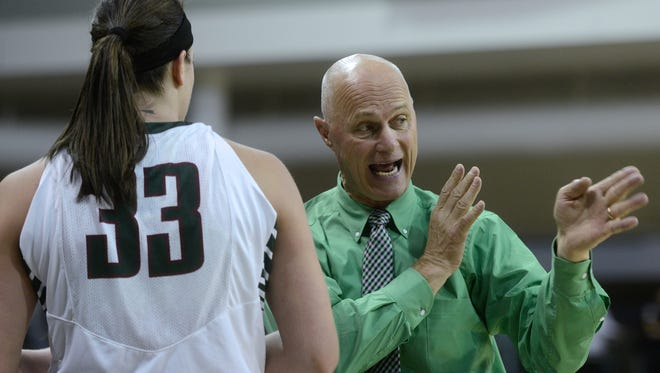 Green Bay Phoenix coach Kevin Borseth advises center Lexi Weitzer after she comes out of the game in the second half.