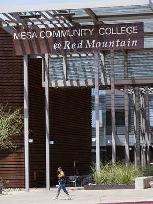 A student walks at Mesa Community College's Red Mountain campus April 6, 2016.