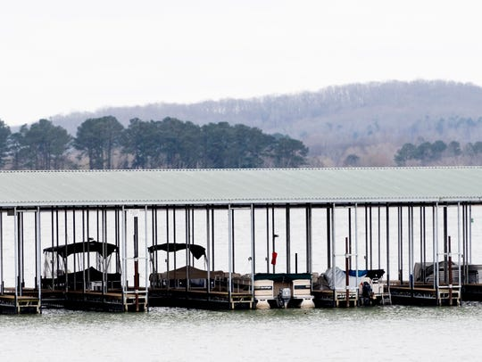 Boats float at a dock on Watts Bar Lake in Kingston,