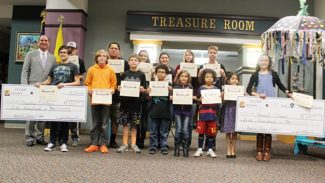 K-12 Winners of the Juried Student Art Exhibition their certificates Friday that they won for their art work.