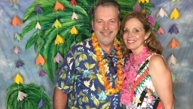 Steven and Susan Smith enjoying the Literacy Luau to benefit the Friends of Literacy at the home of Jeanie and Chip Johnson.