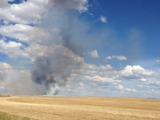 A fire burns off HIghwood Road east of Great Falls.