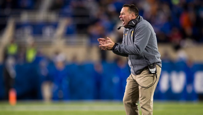 Tennessee Head Coach Butch Jones calls out to his players during Tennessee's game against Kentucky at Kroger Field in Lexington on Saturday, Oct. 28, 2017.