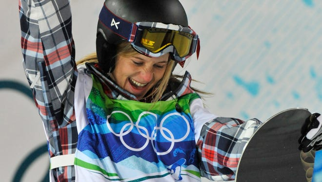 USA's Hannah Teter celebrates her first run score of 42.4  in the women's halfpipe finals which would hold up for the silver medal.