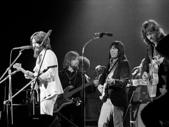 George Harrison, left, performs Aug. 1, 1971, at a benefit concert for East Pakistani refugees at Madison Square Garden in New York, Backing him up are (from left to right): Klaus Voorman (bass), Jesse Ed Davis (guitar) and Eric Clapton (guitar).