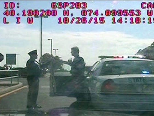 Dashcam video shows State Police Sgt. First Class Michael Roadside (right) being interviewed by another trooper after his patrol car rear-ended a car in the Monmouth Service Area in Wall Township.  Roadside was charged with driving while intoxicated.  IMAGE PROVIDED BY NJSP ~