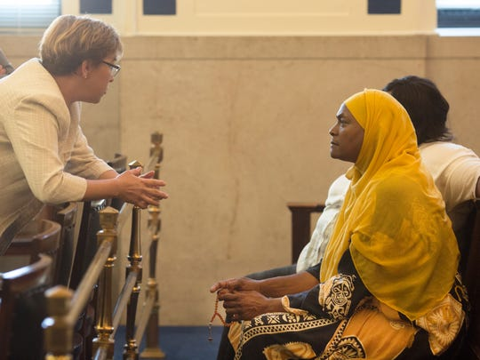 Rukiye Abdul-Mutakallim, right, talks with Jennifer