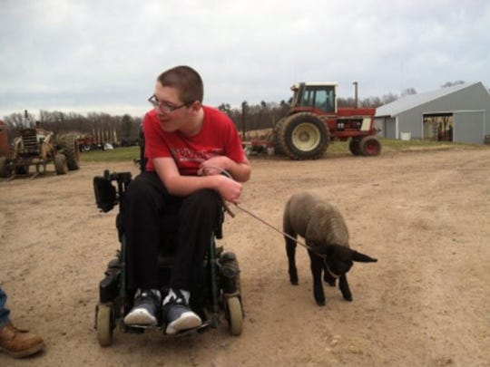Brandon Skinner knows a thing or two about rough roads from his weekly visits to the farm of family friends Denton and Amy Hanson, where he's training three lambs from his wheelchair to show at the Barron County Fair.