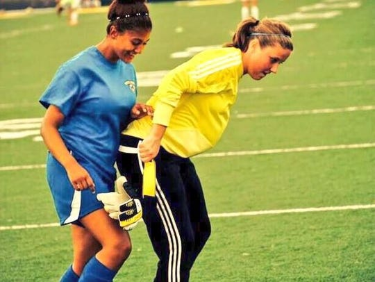 Kelsie (right) was a member of Purcell Marian's soccer