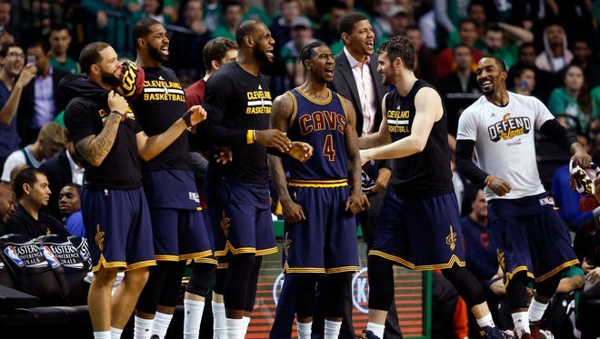 Cleveland Cavaliers forward LeBron James (23), guard Iman Shumpert (4), and teammates celebrate a score during the fourth quarter of game five of the Eastern conference finals of the NBA Playoffs against the Boston Celtics.