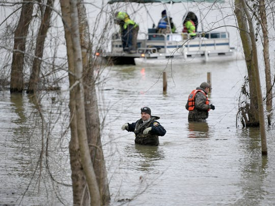 Emergency personnel from Nashville and Houston County search Wednesday, March 7, 2018 in the Tennessee River in Humphreys County for missing Nashville Fire Department firefighter Jesse Reed. He disappeared early Monday after his vehicle plunged into the water near Mason's Boat Dock in Waverly, authorities said.