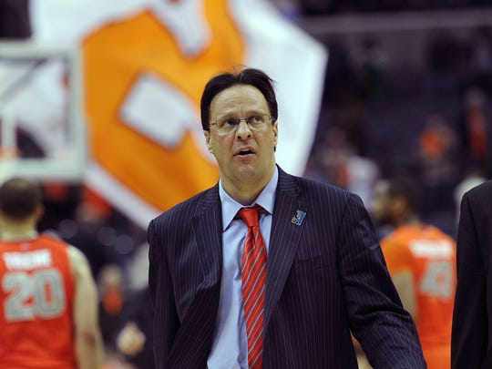 Tom Crean walks off the court after losing to Syracuse