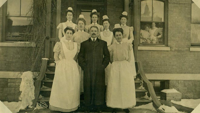 Nurses on the steps of Mary Fletcher Hospital. Violet Martin Reeves is second from the left. She graduated from The Mary Fletcher Hospital Training School for Nurses in 1911.
