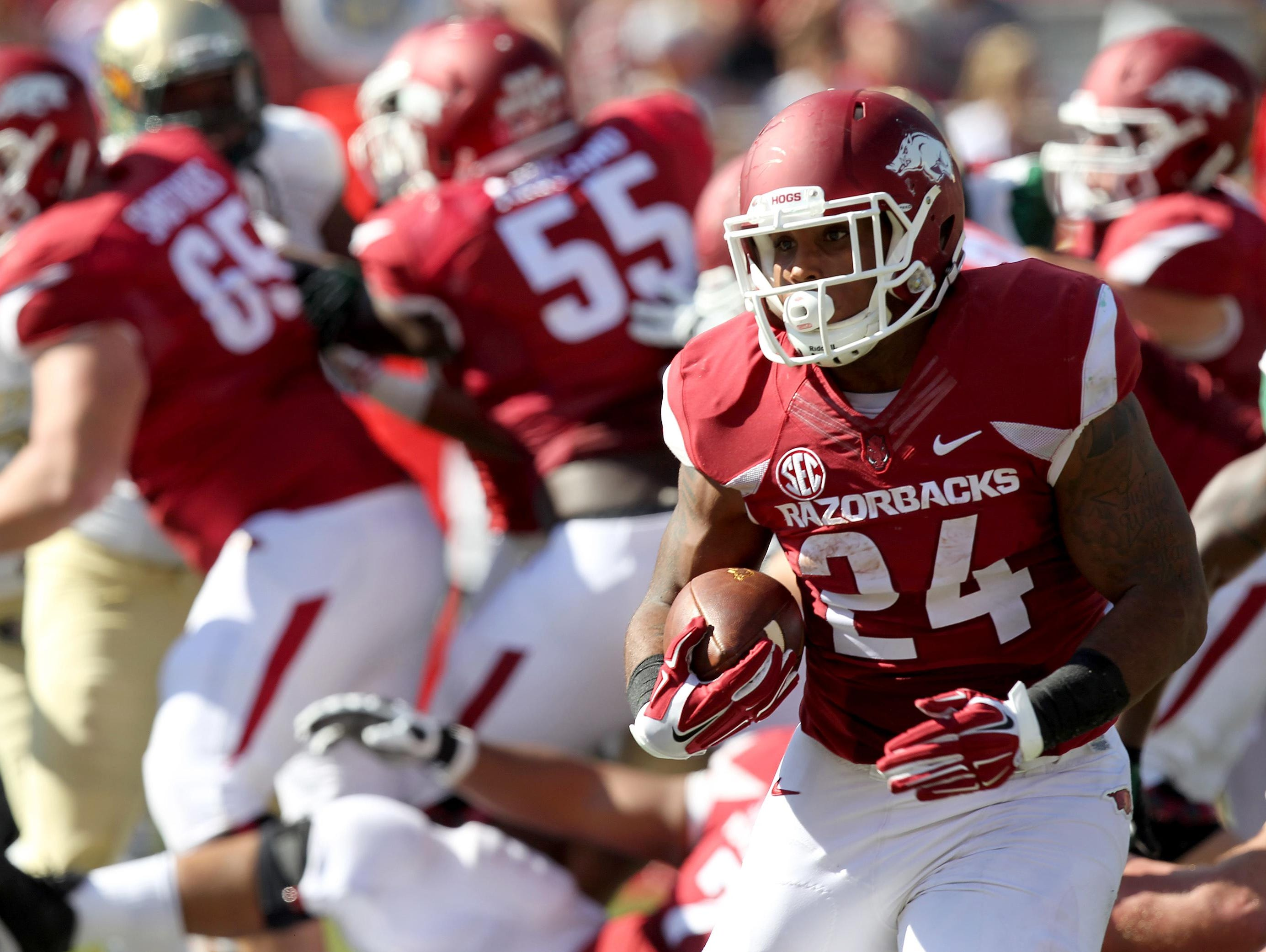 Arkansas Razorbacks running back Kody Walker (24) rushes against the UAB Blazers at Donald W. Reynolds Stadium in Fayetteville last season. Walker was granted a sixth year of eligibility by the NCAA on Wednesday.