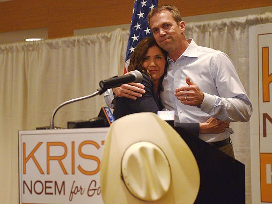 GOP gubernatorial candidate Kristi Noem hugs her husband Bryon Noem before she gives her acceptance speech Tuesday, June 5, after the results are in at the Hilton Garden Inn in downtown Sioux Falls.