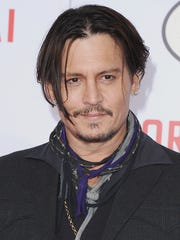 """HOLLYWOOD, CA - JANUARY 21:  Actor Johnny Depp arrives at the Los Angeles Premiere Of """"Mortdecai"""" at TCL Chinese Theatre on January 21, 2015 in Hollywood, California.  (Photo by Jon Kopaloff/FilmMagic)"""
