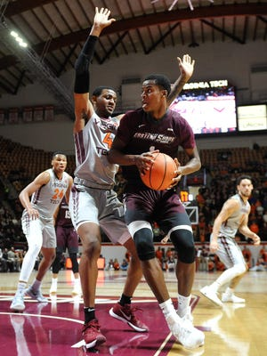 Maryland-Eastern Shore Hawks forward Miryne Thomas drives to the basket while being defended by Virginia Tech Hokies guard/forward Nickeil Alexander-Walker in the first half at Cassell Coliseum on Dec 10, 2017 in Blacksburg, VA.