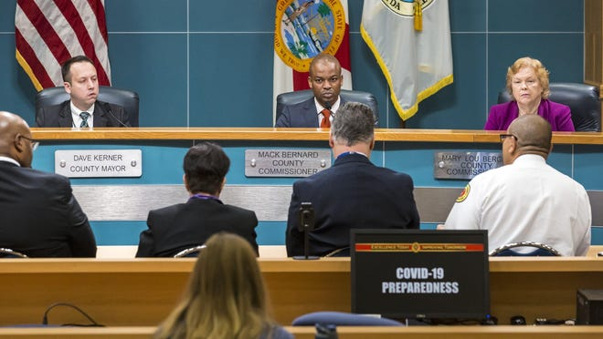 County mayor Dave Kerner, left, and commissioners Mack Bernard and Mary Lou Berger listen to various county leaders talk about coronavirus preparations March 10.