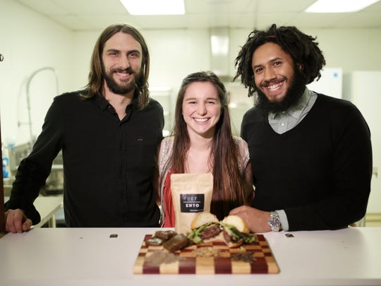 Detroit Ento cofounder Theodore Kozerski, 26, of Detroit, managing partner Farrin Forsberg, 25, of Lansing and cofounder Anthony Hatinger, 26, of Detroit display food made with insect protein powder at their kitchen Feb. 26, 2016, at the New Center in Detroit.