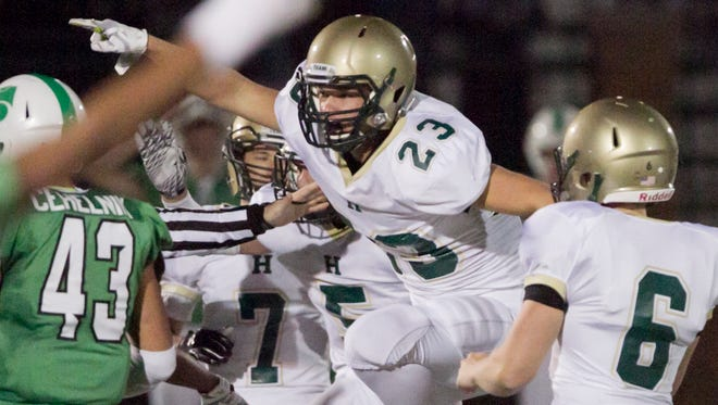 Howell's Trevor Wetzel celebrates after the Highlanders recovered an onside kick late in Friday's loss at Novi.
