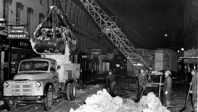 A crew removes the snow from Sixth Street after a big 1950 snow storm.