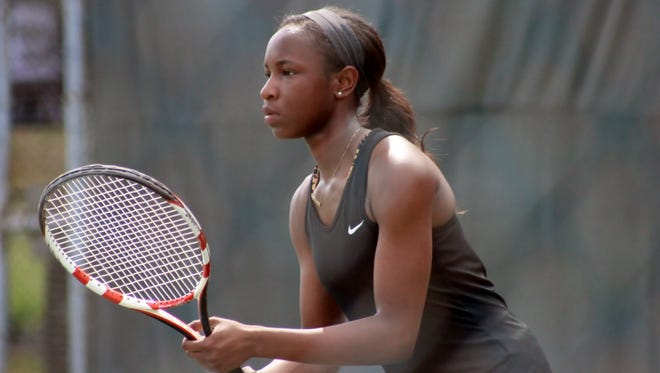 Neville's Chika Ifediora awaits a serve during the LHSAA state tennis championship on Monday.