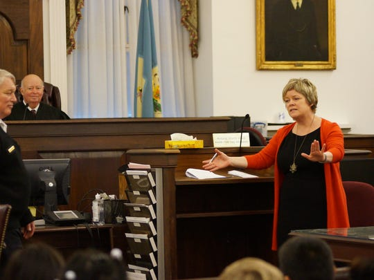"Amy Quinlan (right) deputy state court administrator, plays her part during the staging of a scene from ""Miracle in 34th Street"" for an audience of elementary school students in the Sussex County Courthouse on Tuesday."
