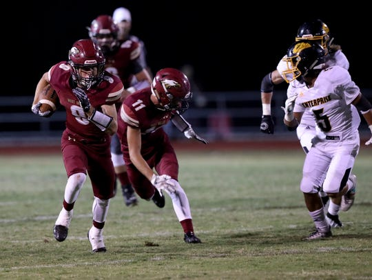 West Valley's Dylan Moore (left, carrying ball) rushes
