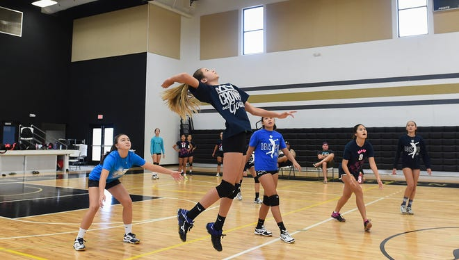 Members of the Haggan Neni U14 girls volleyball team practice at the Tiyan High School Gym on June 22, 2017. The U14 team, along with the U18 team, will compete in the USA Volleyball Girls' Junior National Championships in Minnesota.