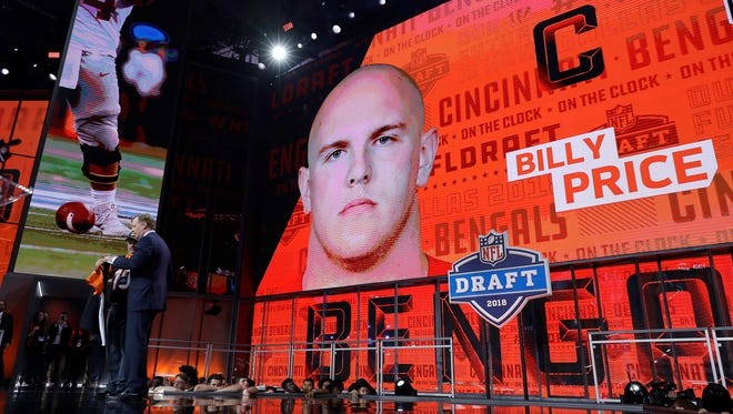 Commissioner Roger Goodell, left, poses with a fan after the Cincinnati Bengals selected Billy Price during the first round of the NFL football draft, Thursday, April 26, 2018, in Arlington, Texas.