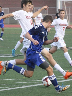 Churchill's Cameron Kozan hustles after a loose ball during Monday's game against Walled Lake Western.