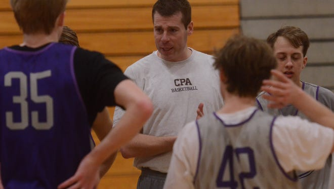 Christ Presbyterian Academy coach Drew Maddux (center) talks to his team during Wednesday afternoon's practice. The Lions are 17-8 after losing six key players from last season, including transfers Braxton Key and Tyger Campbell.