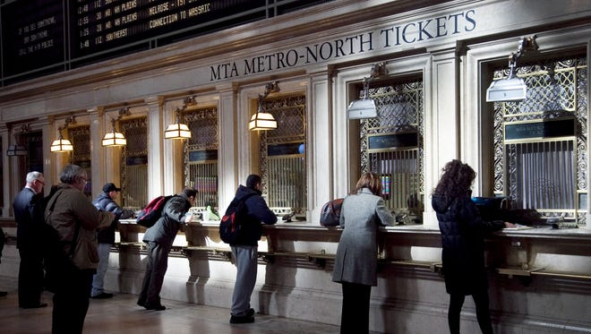Commuters purchase tickets for Metro-North Railroad in this file photo.