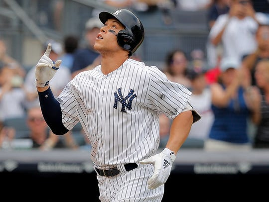 New York Yankees' Aaron Judge reacts as he heads down