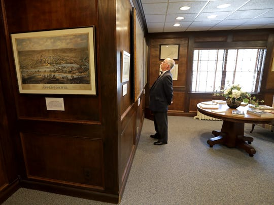 Appleton Historical Society president Tom Sutter spends time in the map room of the society's new museum and resource center, which opened to the public on Thursday in Appleton.