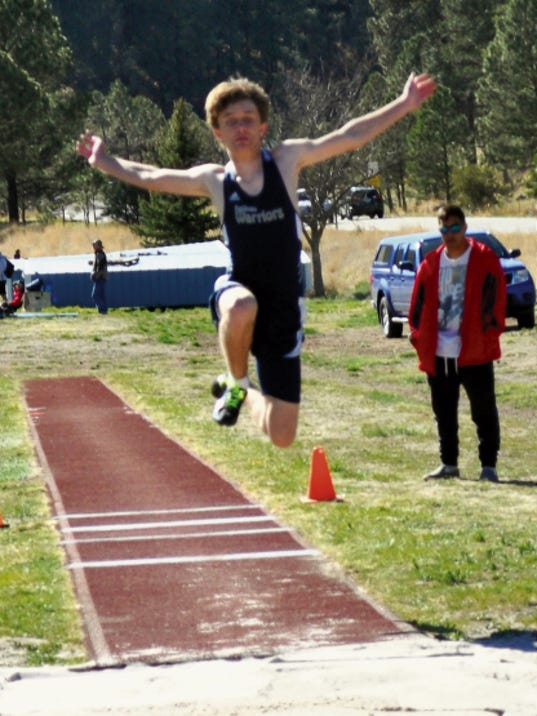Michelle Huey — Ruidoso News Zachary Parra, seen here competing in the long jump, will run with the relay team at state.