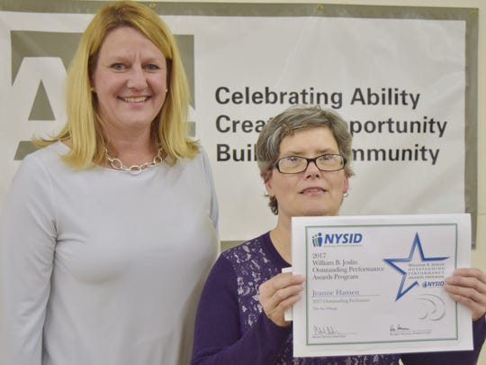 Sara Erickson (left) presents Jeanne Hansen the Outstanding Performance Award from the New York State Industry for the Disabled.