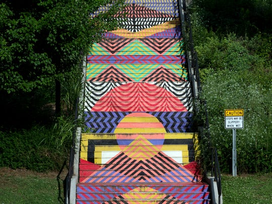 """Weaving Rainbow Mountain"" by Jessie Unterhalter and Katey Truhn is on Cumberland Avenue steps between Estabrook Road and Poplar Street."