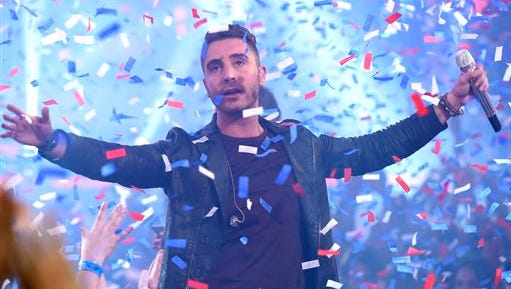Nick Fradiani reacts after he is announced as the winner at the American Idol XIV finale at the Dolby Theatre on Wednesday, May 13, 2015, in Los Angeles. (Photo by Chris Pizzello/Invision/AP)