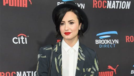 FILE - In this Feb. 7, 2015, file photo, Demi Lovato arrives at the Roc Nation Pre-Grammy Brunch at RocNation Offices in Beverly Hills, Calif. Lovato is sharing her personal story and encouraging others to do the same through Be Vocal: Speak Up For Mental Health, an initiative launched Thursday, May 28, 2015, by a pharmaceutical company, the National Alliance on Mental Illness and other mental-health advocacy groups. Its aim is to improve treatment options at all levels and erase the stigma around mental illnesses. (Photo by Rob Latour/Invision/AP, File)
