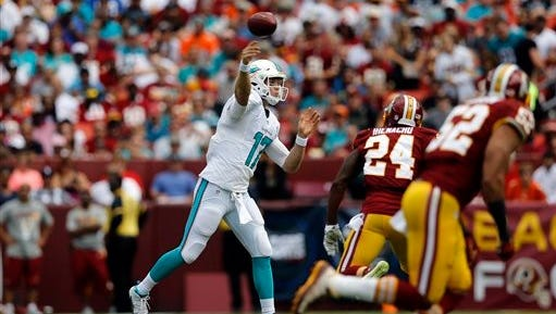 Miami Dolphins quarterback Ryan Tannehill (17) throws in front of Washington Redskins defensive back Duke Ihenacho (24) during the first half of an NFL football game Sunday, Sept. 13, 2015, in Landover, Md. (AP Photo/Patrick Semansky)