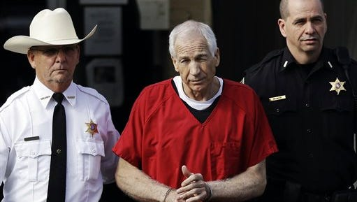 former Penn State assistant football coach Jerry Sandusky, pictured as he's taken from the Centre County Courthouse after being sentenced, will have his Penn State pension returned after a court ruling.