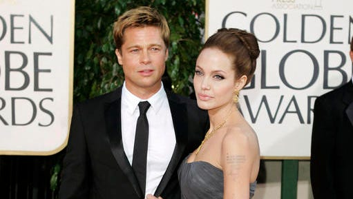 In this Jan. 15, 2007 file photo, Brad Pitt and actress Angelina Jolie arrive for the 64th Annual Golden Globe Awards in Beverly Hills, Calif. Jolie filed for divorce from Pitt in September.